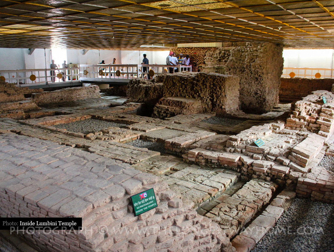 Bên trong đền thờ Hoàng hậu Ma Da là di tích nền gạch cũ cổ xưa. Inside the Mayadevi Temple